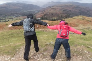Fighting the wind on Loughrigg summit