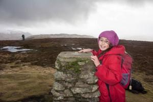 Hannah on the summit of Little Mell Fell