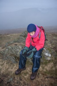 Hannah, at the end of tough day, sat on Goat Scar, Kentmere, Cumbria