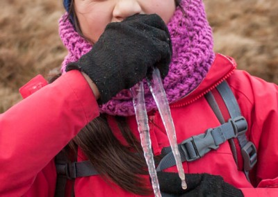 Hannah finds icicles to play with on Kentmere Pike, pretending to be a walrus