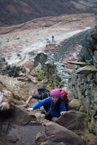 Hannah negotiates the rock step before Low Pike