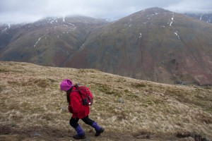 Hannah climbs Steel Fell, Seat Sandal in background