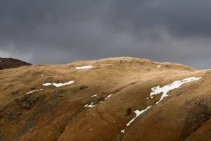 Walkers on the ridge, approach the summit of Steel Fell
