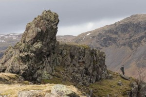 A walker looks at 'the howitzer' on helm Crag
