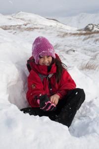 Hannah in snow cave on Wansfell