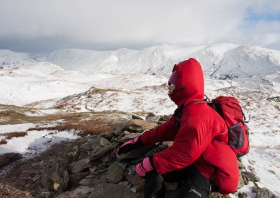 Walker on the summit of Wansfell