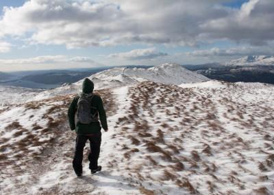 Walker heads towards Wansfell Pike from Wansfell