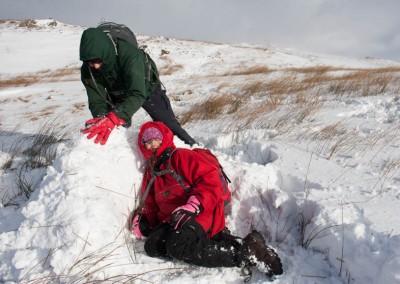 Hannah and Mark build snow wall near Wansfell Pike