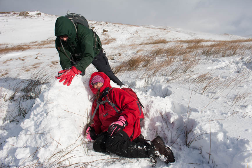 Hannah and Mark build snow wall near Wansfell Pike