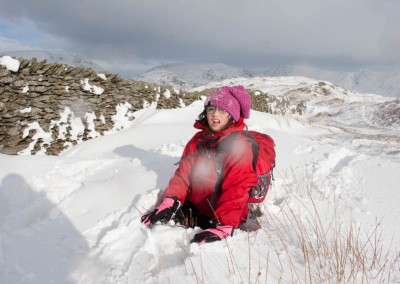 Hannah in snow drift on Wansfell Pike