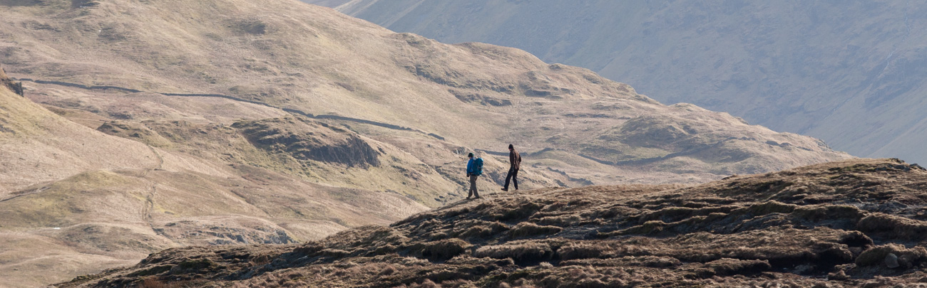 Walkers descend Place fell towards Boredale Hause