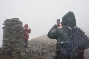 Hannah and Mark on Dale Head in driving wind and rain
