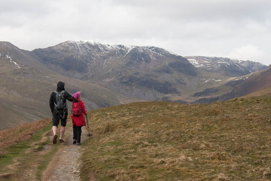 Hannah and Mark head towards Grisedale Pike with the Coledale Valley, Eel Crag and Grasmoor ahead of them