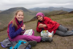 Hannah and Georgia enjoying lunch on the summit of Ard Crags