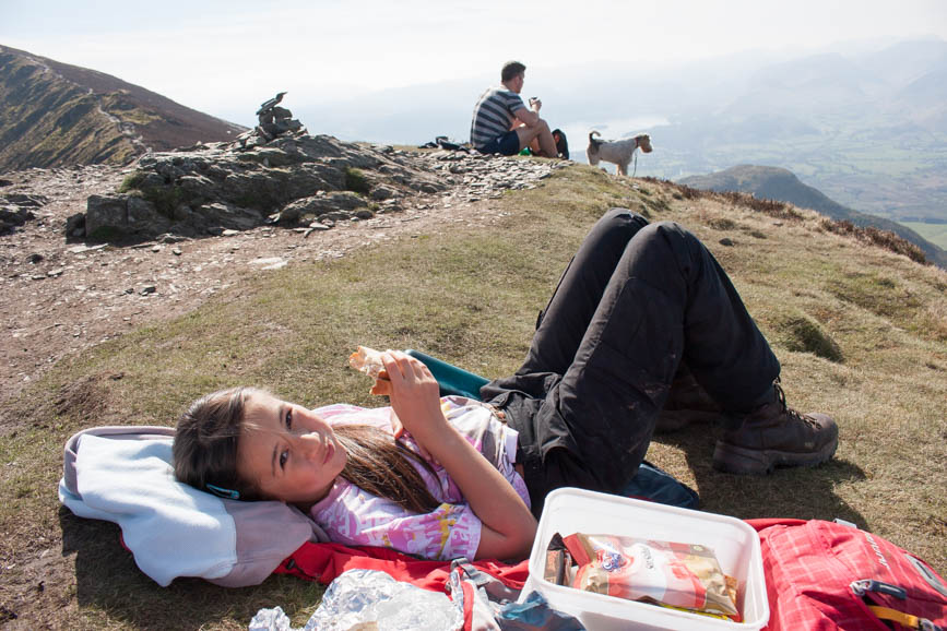 Hannah having a well earned rest on the summit of Ullock Pike