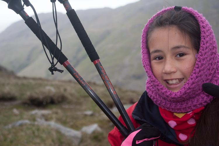 Hannah with her Pacer Poles on The Band heading for Bowfell