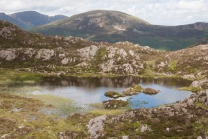 Innominate Tarn on Haystacks with Robinson reflecting in the water