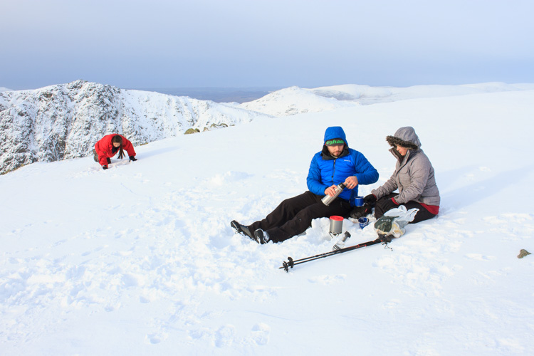 Tea on the snow-covered summit of Coniston Old Man