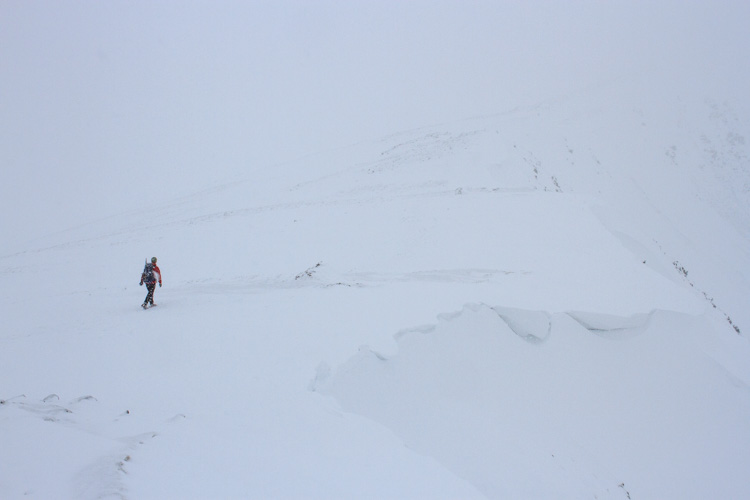 A climber on Dow Crag during a whiteout