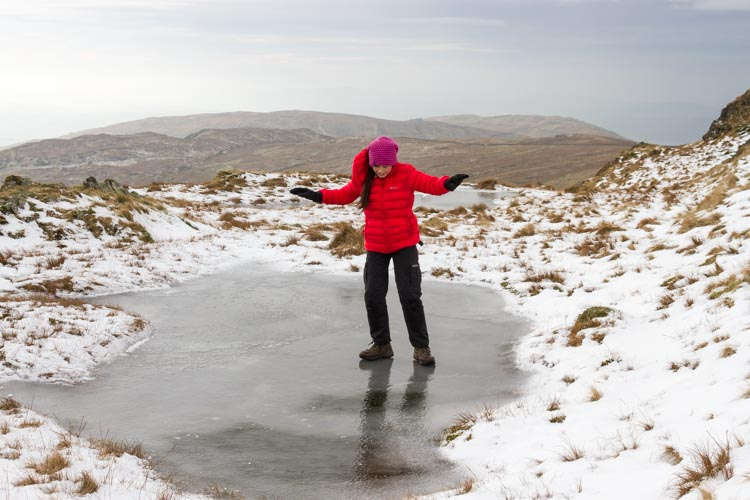 Hannah skating on the frozen tarn on Yoke