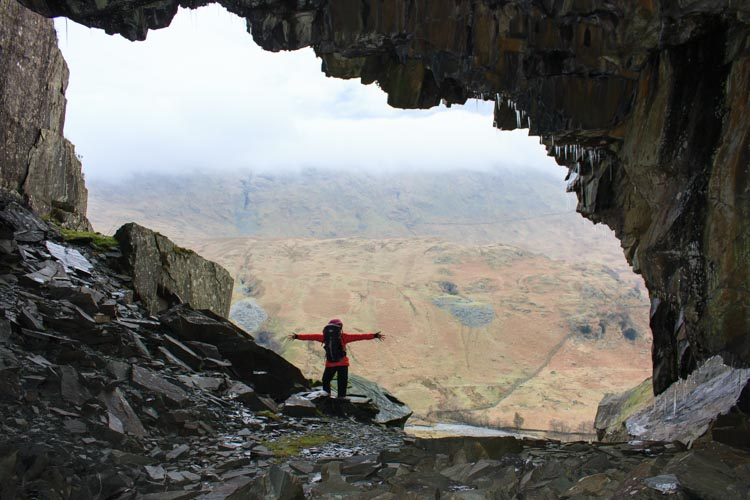 Looking out of a mine entrance on Rainsborrow Crag towards Kentmere Fell